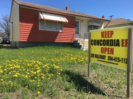 """A house in Transcona with a """"Keep Concordia ER open"""" sign on it's front lawn."""