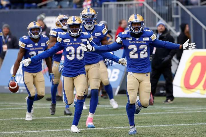 Winnipeg Blue Bombers' Winston Rose (30) and Chandler Fenner (22) celebrate Fenner's interception during the second half of CFL action against the Montreal Alouettes, in Winnipeg, Saturday, Oct. 12, 2019. THE CANADIAN PRESS/John Woods