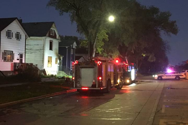 Streets closed while firefighters battle house fire on Ross Avenue - Winnipeg