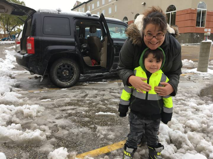 Jessica Swan and her son travelled to Winnipeg to stay in a hotel instead of coping without power at home.