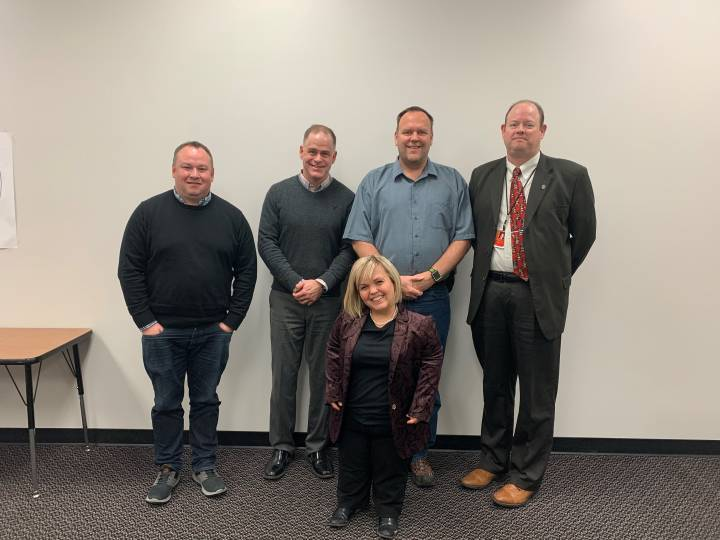 Samantha Rayburn-Trubyk (front) in Dickinson, N.D., with (from left) her husband Ryan Trubyk, school board president Brent Seams, Daren Stenvold (father of a child born with dwarfism), and superintendent Dr. Hocker.