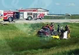 First responders at the crash site south of Letellier Friday afternoon.