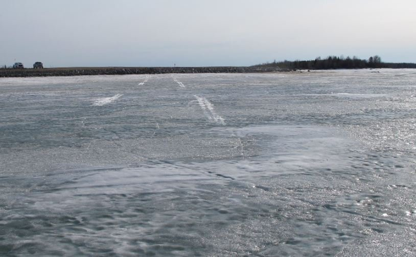 Skid marks on a frozen lake where a plane was forced to make an emergency landing near Gillam, Manitoba in April, 2019.