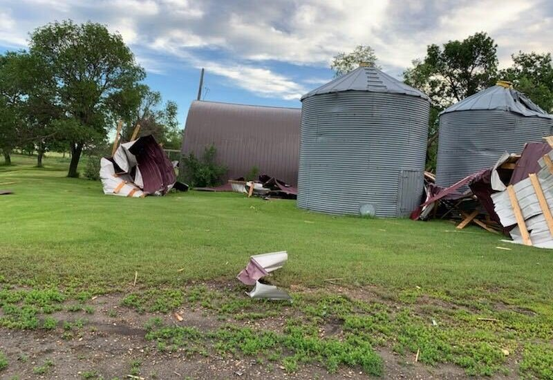 Grain bins were toppled on Corey Schroeder's farm Monday.