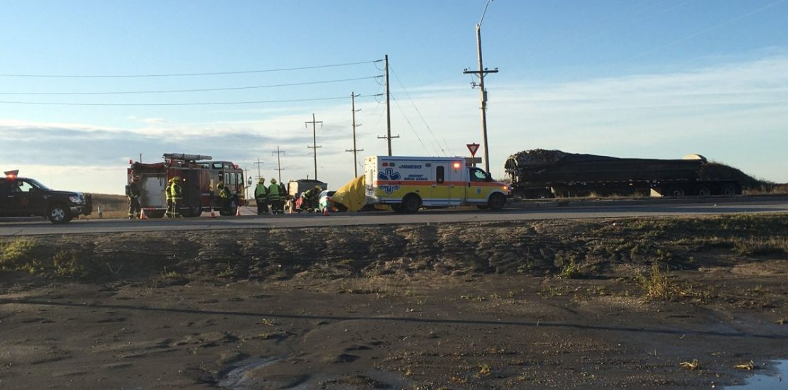 Emergency personnel at the scene of a serious crash on the South Perimeter near Brady Road Oct. 25.